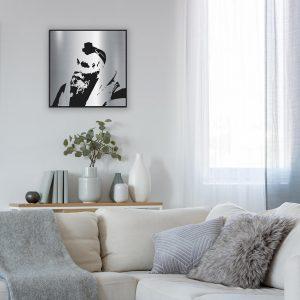 Rav Shteinman metal portrait on wall in living room