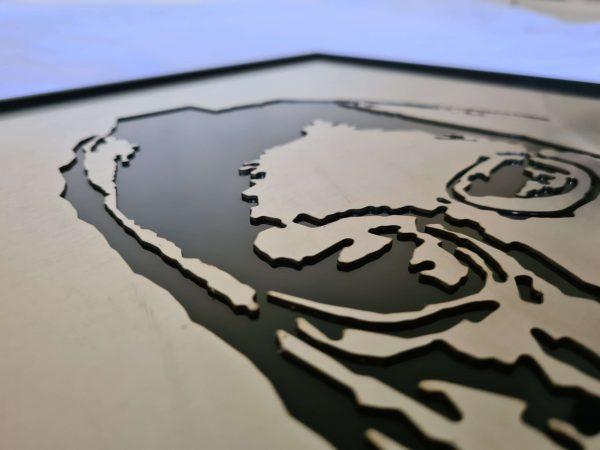Metal detail of Rav Elyashiv portrait