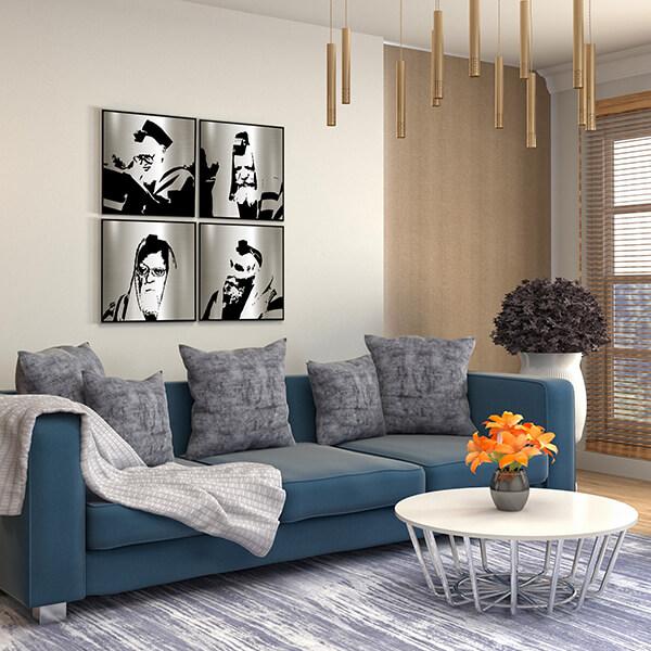 Metal rabbonim portraits of gedolim on a living room wall